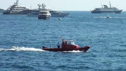 Coast guard boat moving with speed and patrolling the coas