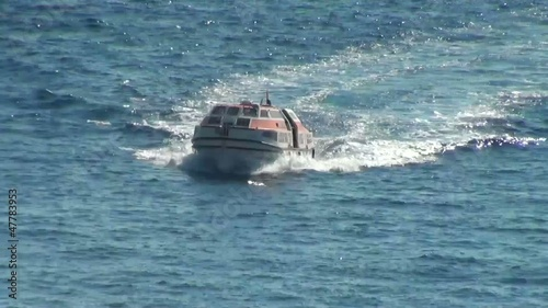 Frontal view of a boat floating with some speed