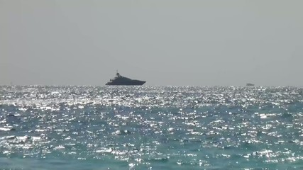 Yacht slowly traveling along the sea