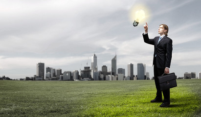 Businessman holding light bulb