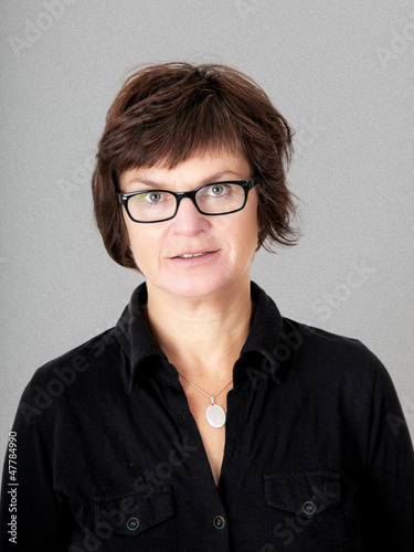 Woman with glasses in middle age