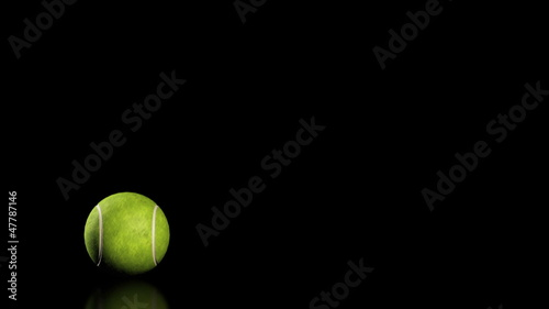 Tennis Ball, jumping on black background, loop
