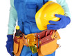 Male builder in blue overalls with yellow helmet  isolated