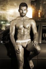 Sexy portrait of a very muscular male model in underwear