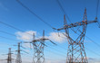 four power high voltage tower over blue sky