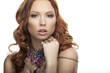 Beautiful redhair model with many multicolored jewelry
