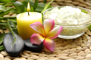 Aromatic candle and tropical spa accessories