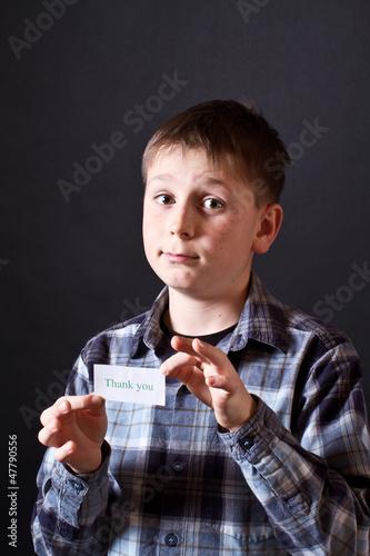 boy shows a card with gratitude
