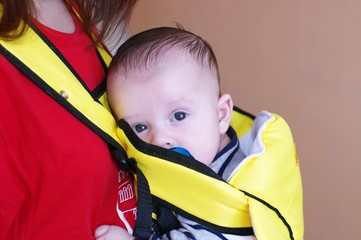 The baby in a baby sling (3 months)