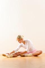 Ballet dancer in leaning posture exercise studio
