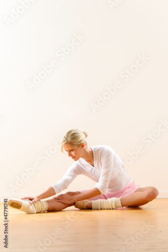 Ballet dancer in leaning posture exercise studio