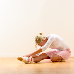 Ballerina bending on her knee
