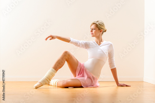 Beautiful woman dancer practicing ballet in studio