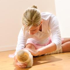 Ballet dancer stretching exercising in the studio
