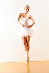 Ballerina exercising ballet pose in the studio