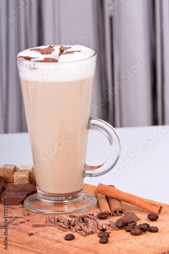 cappuccino with coffee beans, cinnamon and chocolat