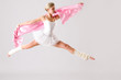 Lovely ballet dancer jumping exercising in studio