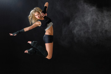 Dancer jumping while performing her dance routine