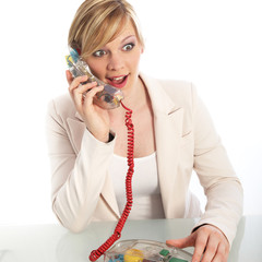 Surprised woman on a landline telephone