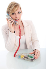 Woman chatting on a landline telephone