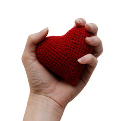 Handmade red heart in a woman's hand