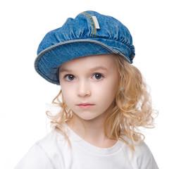 Little calm girl portrait in cap