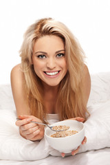 Beautiful blonde enjoying a healthy breakfast