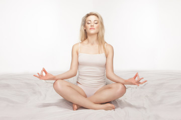Beautiful blonde woman meditating