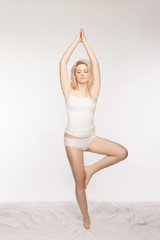 Serene blonde woman practising yoga