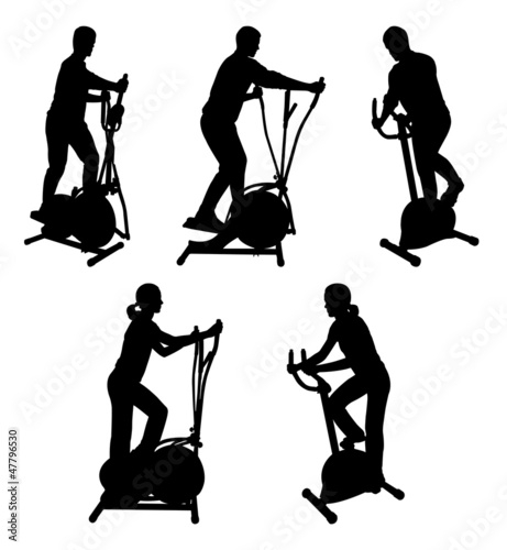silhouettes of fitness people on gym bikes