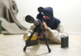 masked sniper aiming rifle
