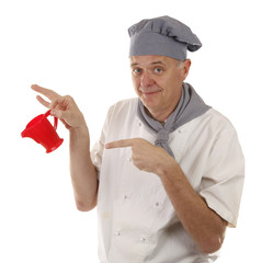 Cook chef is showing little red pitcher