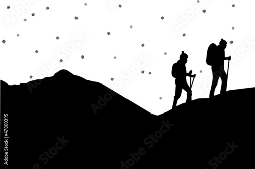 Mountain climbing in winter, hiking couple with rucksacks
