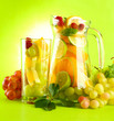 jar and glass with citrus fruits and raspberries,