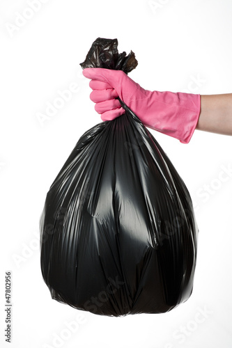Hand holding trash bag
