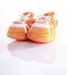 Orange baby boots isolated