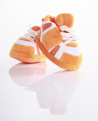 Orange baby boots isolated