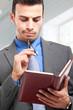 Businessman checking his agenda