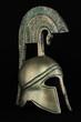 Ancient greek helmet replica on black background