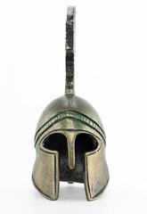 Ancient greek helmet replica on white background