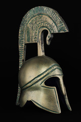 Ancient greek helmet replica on black background