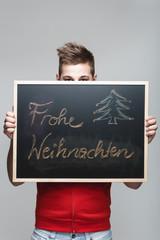 Frohe Weihnachten auf einer Tafel
