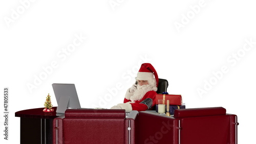Santa Claus checking blood pressure and talking on mobile