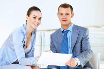 a portrait of a businesswoman and businessman