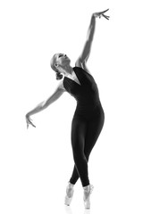 young wonderful ballerina is dancing gracefully