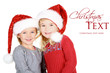 Two children wearing Santa hats