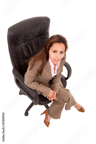 Portrait of beautiful young woman sitting on chair, isolated on