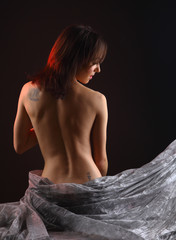 Naked torso of a beautiful young woman's back