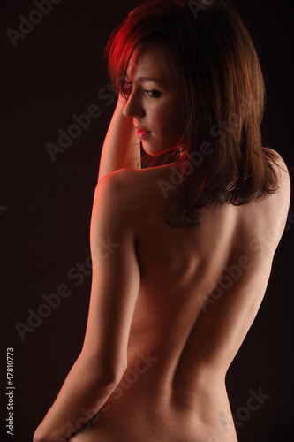 Young beautiful nude woman's torso from behind
