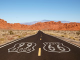 Route 66 Pavement Sign with Red Rock Mountains - 47811555